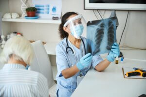 Woman hospital specialist holding a chest radiograph